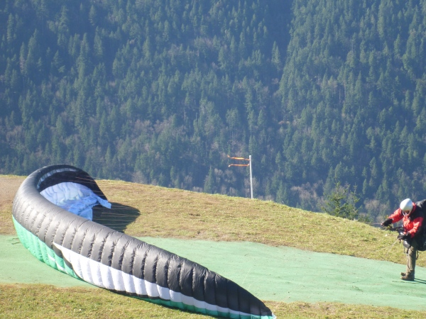 A paraglider preparing his parachute at Poo Poo Point